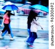 big city people walk on road in rainy day - stock photo