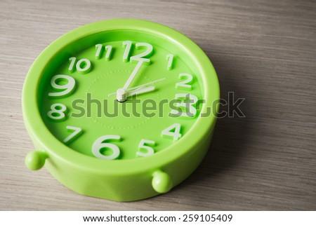 big clock on wood background - stock photo