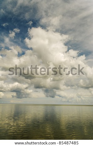 Big clouds above Baltic sea. - stock photo