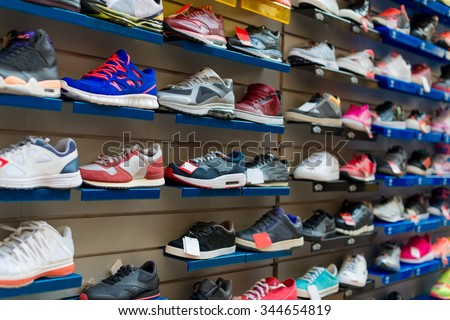 Big collection of different sport shoes. - stock photo