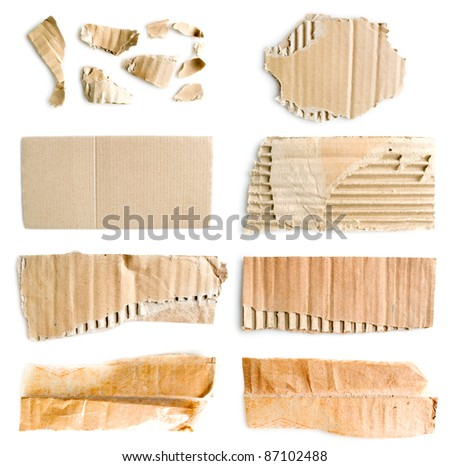 Big collection of torn corrugated cardboard isolated on white background