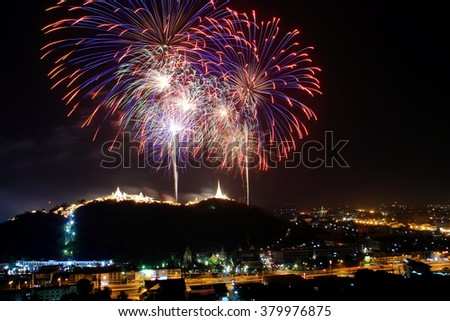 Big Colorful fireworks over the city (Annual Fair at Phra Nakhon Kiri, Phetchaburi, Thailand) - stock photo