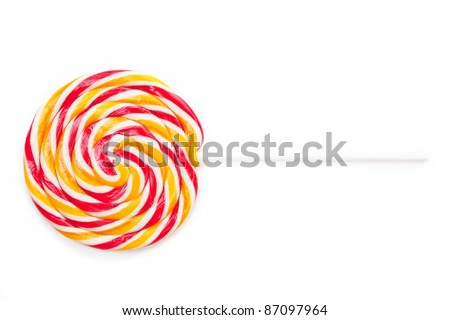 Big colorful round lollipop isolated on white background. Delicious sweets. - stock photo