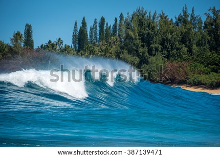 Big colorful waves crashing on the North Shore of Kauai, Hawaii on a sunny day