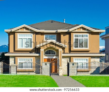 Big comfortable house with dark blue sky as a background