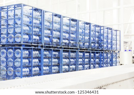 Big constitution for storage of finished goods at a factory on manufacture of mineral water - stock photo