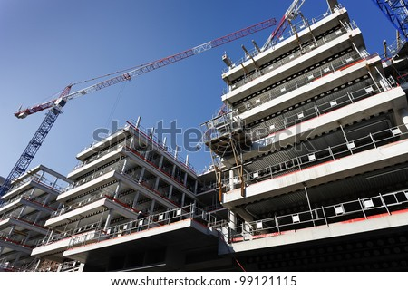 big construction site with crane and blue sky - stock photo