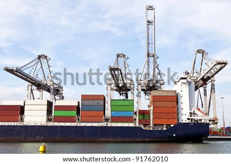 big container ships with cranes in the harbor of rotterdam netherlands - stock photo