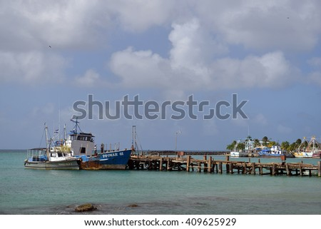 BIG CORN ISLAND, NICARAGUA-JAN. 13: A commercial fishing boat is seen in harbor of Brig Bay in Big Corn Island, Nicaragua on January 13, 2015. - stock photo