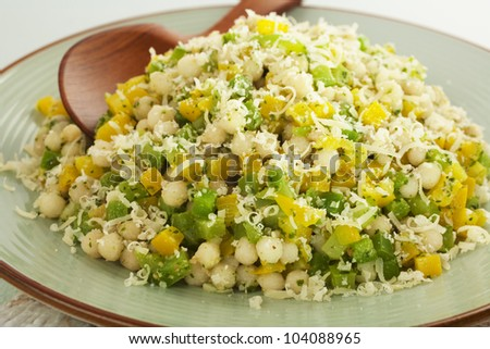 couscous or pearl couscous, in a vegetarian salad with spinach pesto ...