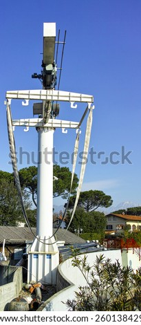 big crane for mooving boat in a harbour in tuscany - stock photo