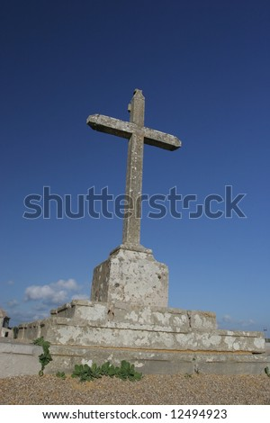 big cross isolated in blue sky, at sunset - stock photo