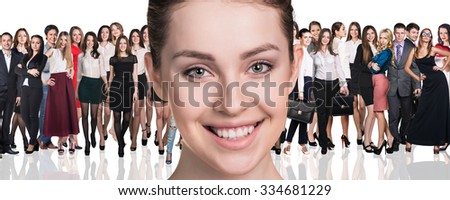 Big crowd of business people and young woman foreground. Isolated over white background - stock photo