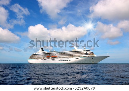 Big cruise liner in the open sea at sunny day