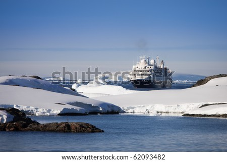 Big cruise ship in Antarctic waters - stock photo