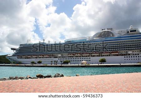 Big cruise ship near tropical island - stock photo