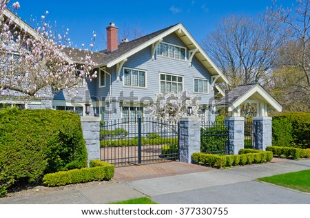 Big custom made luxury house, residence behind the gates in the suburbs of Vancouver, Canada. - stock photo