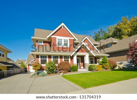 Big custom made luxury house with long driveway in the suburbs of Vancouver, Canada. - stock photo