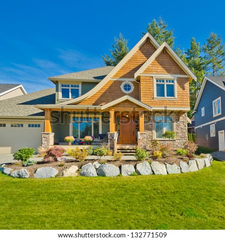 Big custom made luxury house with nicely designed front yard in the suburbs of Vancouver, Canada. - stock photo