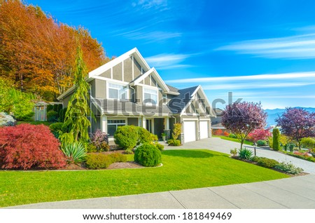 Big custom made luxury house with nicely landscaped front yard and double doors garage in the suburbs of Vancouver, Canada. - stock photo