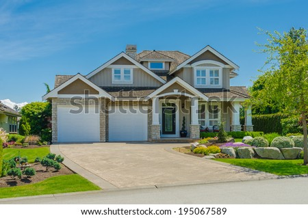 Nicely trimmed manicured garden front luxury stock photo for Nice houses in canada
