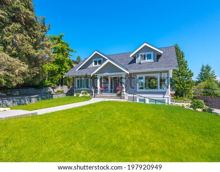 Big custom made luxury house with nicely trimmed and landscaped front yard  in the suburb of Vancouver, Canada. - stock photo