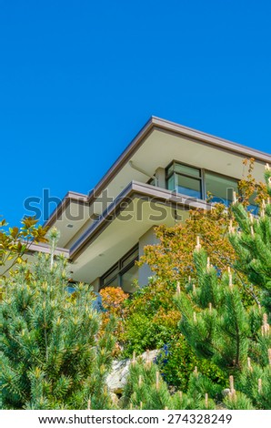 Big custom made luxury modern house with nicely landscaped front yard in the suburbs of Vancouver, Canada. Vertical.