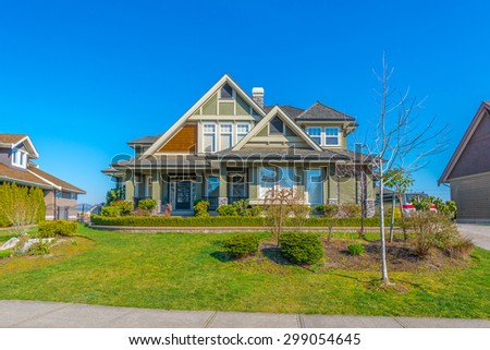 Big custom made luxury modern house with nicely landscaped front yard in the suburbs of Vancouver, Canada.