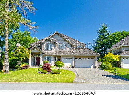 Big custom made with triple doors garage luxury house in the suburbs of Vancouver, Canada.