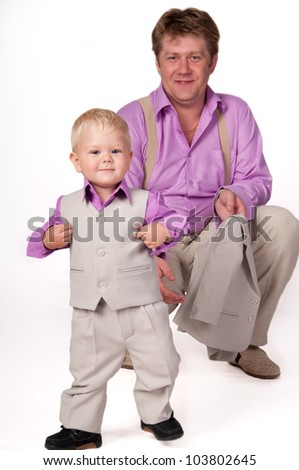 Big Daddy and the little boy in business suits. - stock photo