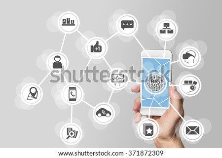 Big data concept in order to analyze large volume of data from connected mobile devices. Hand holding smart phone on white background - stock photo