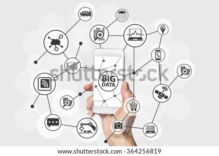 Big Data concept with hand holding modern smart phone - stock photo