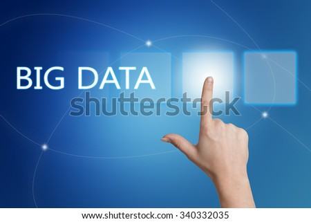 Big Data - hand pressing button on interface with blue background. - stock photo
