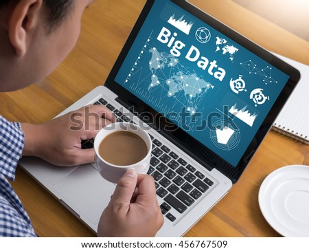 Big Data on Domain Web Page and  SEO Businessman at work. Close-up top view of man working on laptop while sitting at the wooden desk , coffee - stock photo