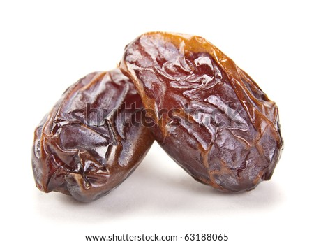 Big date dried fruit closeup on white background - stock photo