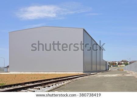 Big Distribution Warehouse Building Exterior - stock photo