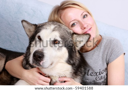 Big dog and the woman - stock photo