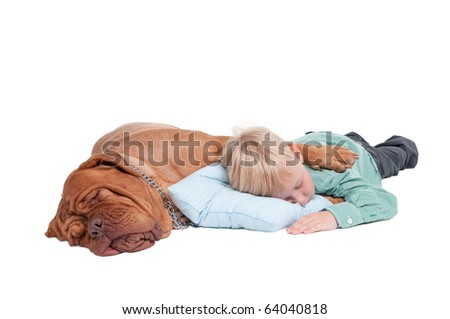 Big dogue de bordeaux hugging a small boy while sleeping on the floor - stock photo