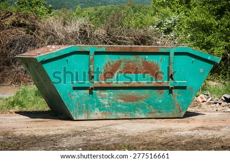 Big dumpster trash in the landfill. - stock photo