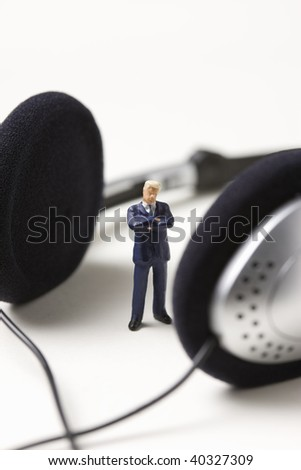 Big earphones and the businessman who pauses.