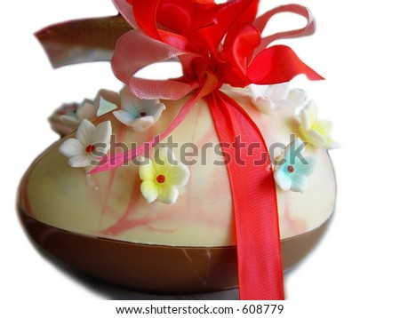 Big easter egg with flowers and red bow (side view) - stock photo