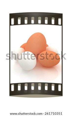 Big egg and eggs. The film strip - stock photo
