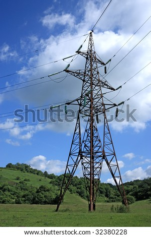 Big electrical tower on meadow - stock photo