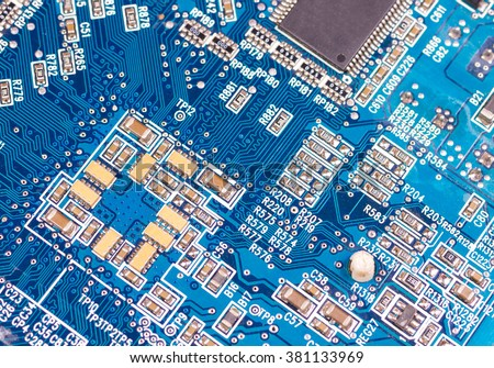 Big Electronic circuit board with radio components soldered on a blue PCB - stock photo