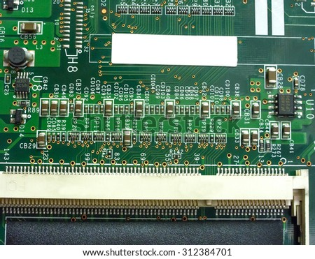 Big Electronic circuit board with radio components soldered on a green PCB - stock photo