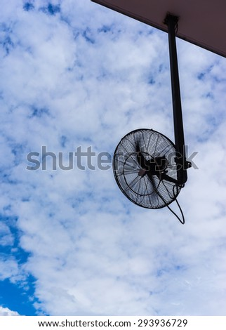 big electronic fan for outdoor using in silhouette with propelle - stock photo
