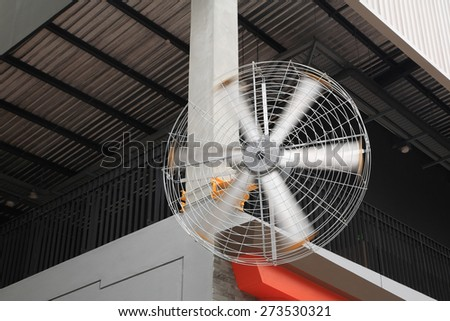big electronic fan to use in outdoor shopping mall, propeller swirling - stock photo