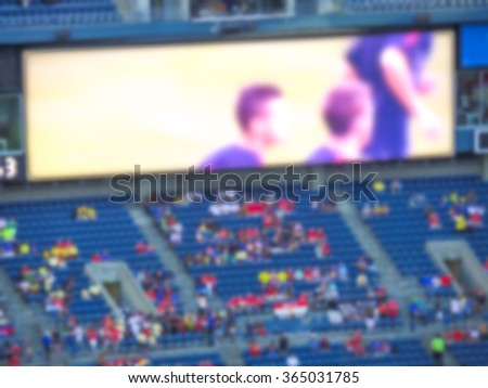 big electronic led billboard display at stadium with a lot of fan,Ready for product display montage. - stock photo