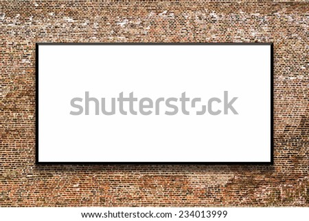 Big empty billboard attached to a brick wall as outdoor advertising copy space. - stock photo