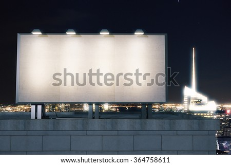Big empty billboard on the background of the city at night, mock up - stock photo
